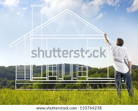 Man drawing a house blueprint in nature - stock photo