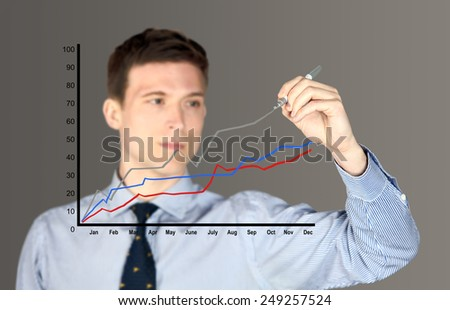 Man drawing a line graph - focus on graph - stock photo