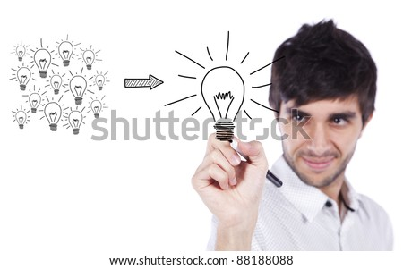 Man drawing a message in a whiteboard, how to manage creativity turning many ideas in one good idea (selective focus) - stock photo