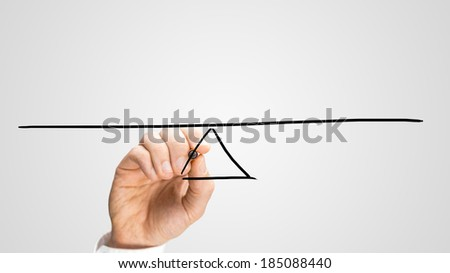 Man drawing a seesaw to demonstrate the concept of a lever and fulcrum, of balance, equilibrium and equality on a grey background with copyspace. - stock photo