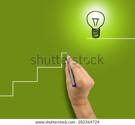 man drawing a staircase to success in business.All screen content is designed by us and not copyrighted by others and created with digitizing tablet and image editor - stock photo