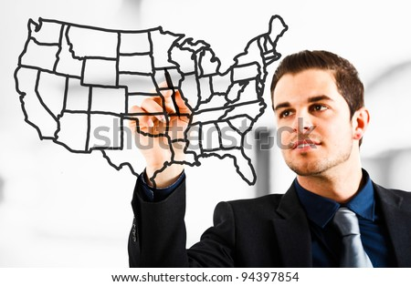 Man drawing an USA map on the screen - stock photo