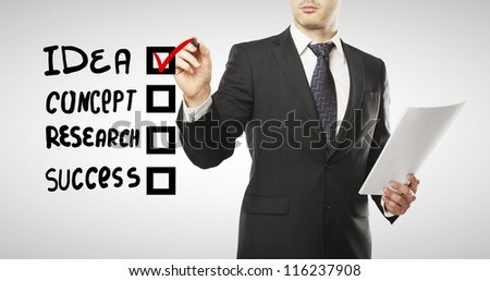 man drawing check box, business  concept - stock photo
