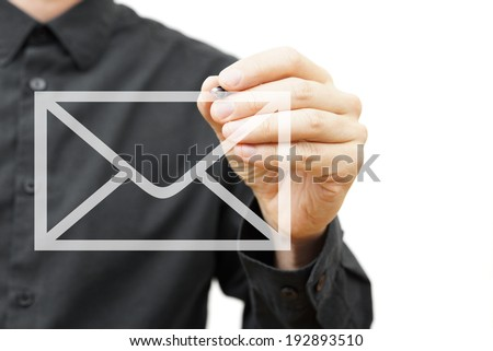 Man drawing email icon on virtual screen.  Contact information concept - stock photo