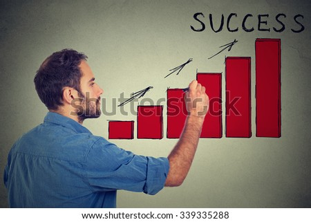 Man drawing future successful earnings result chart  - stock photo