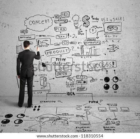 man drawing global concept on concrete wall - stock photo