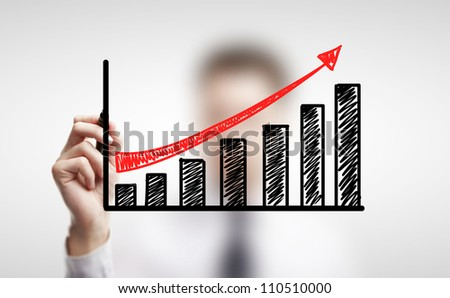 man drawing schedule of business growth - stock photo