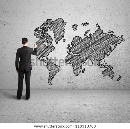 World map drawing stock images royalty free images vectors man drawing world map on concrete wall gumiabroncs Choice Image