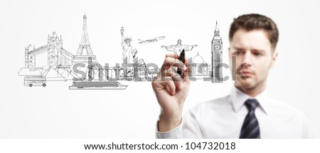 man draws outline a architectural buildings - stock photo