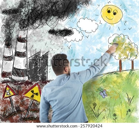 Man draws the difference in a landscape - stock photo