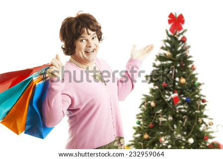 Man dressed as woman going on a Christmas shopping spree, holding bags.  Isolated on white.   - stock photo