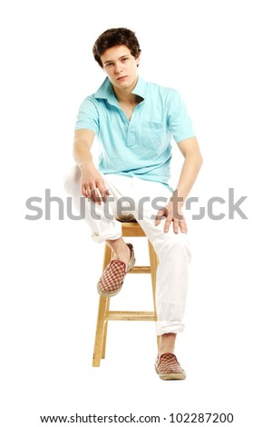 Man dressed in summer style sitting on stool