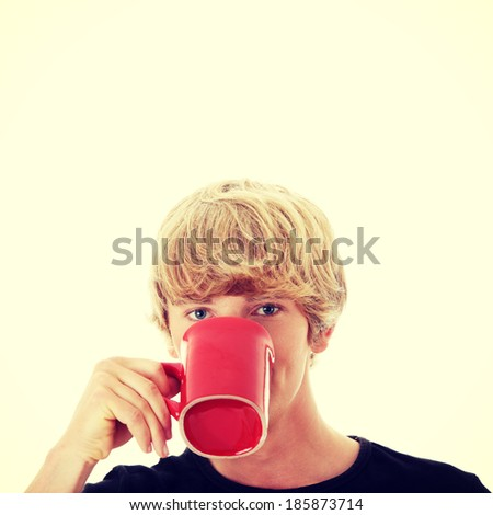 Man drinking a coffee or tea - stock photo