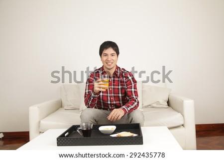 Man drinking a juice - stock photo