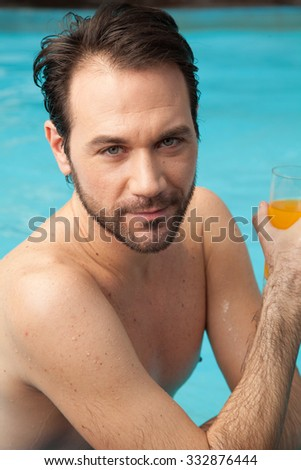 Man drinking a juice at the pool