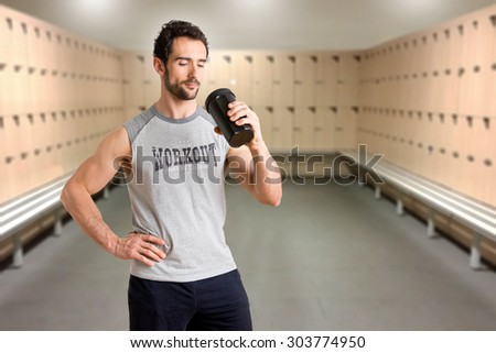 Man drinking a protein shake after a workout in the gym - stock photo