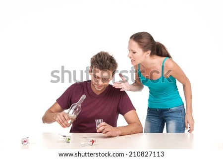 Man drinking alcohol and woman shouting at him. Photo of family conflict with alcoholic husband on white background