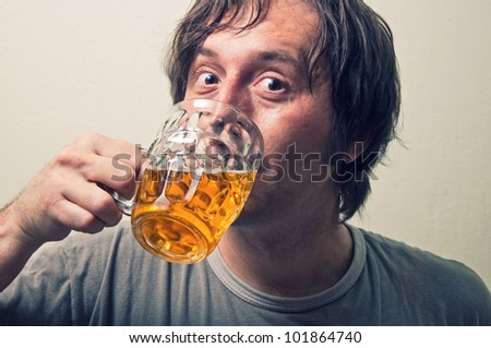 Man drinking beer - stock photo