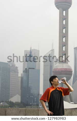 Man drinking bottled water.