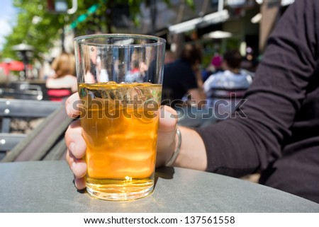 Man drinking cider in terrace - stock photo
