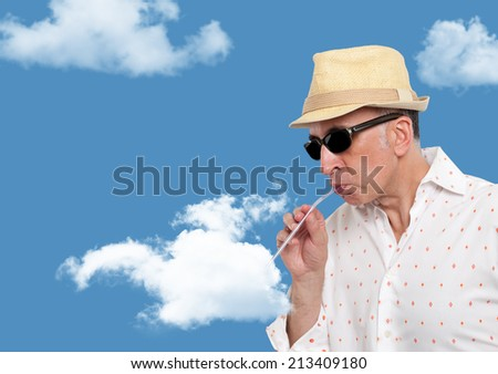 Man drinking from a cloud - stock photo