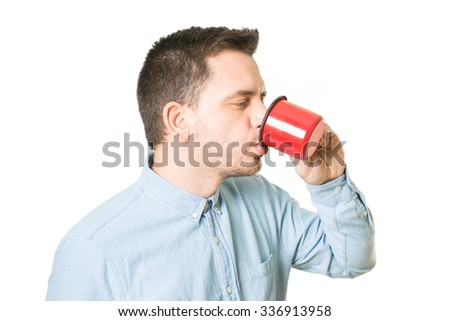 Man drinking from a red cup