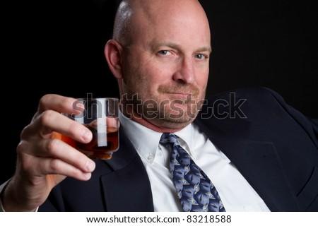 Man drinking scotch whiskey alcohol - stock photo