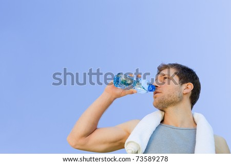 Man drinking water after the gym - stock photo