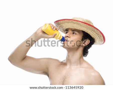 Man drinking water from a water bottle - stock photo