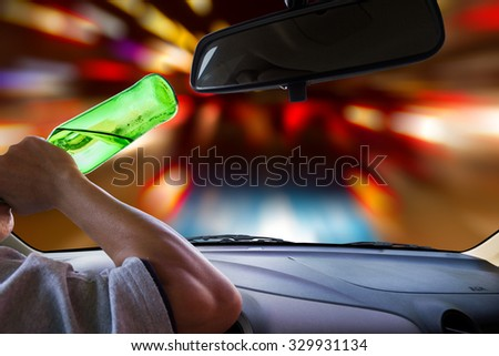 Man drinking while driving. - stock photo