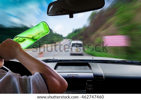 Man drinking while driving, motion image of road are repaired as background.