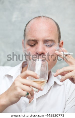 Man drinking wine and smoking