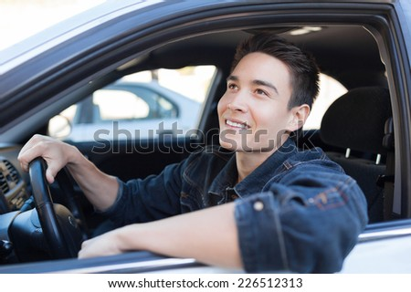 Man driver driving a car