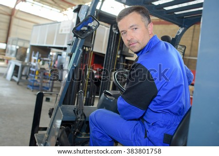 man driving a warehouse vehicle