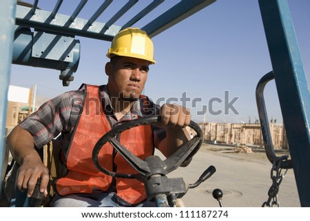 Man driving bulldozer at construction site - stock photo