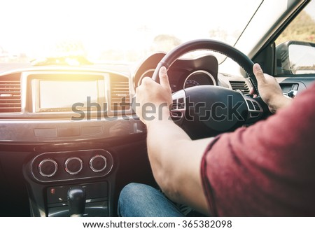 man driving car (control wheel mounted right). Vintage filter process style - stock photo