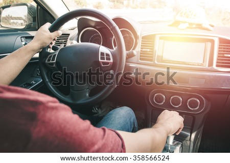 man driving car. Vintage filter process style - stock photo