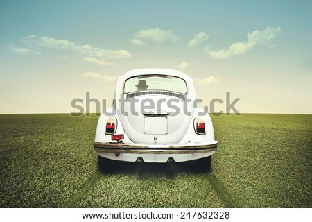 Man driving off road on a white car - stock photo