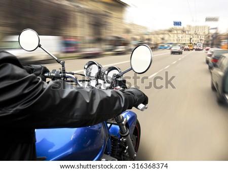 Man driving on moto on big speed on asphalt road - stock photo