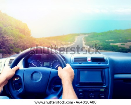 Man driving the car in the evening