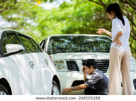 Man driving the car of a woman. She was angry This accident - stock photo