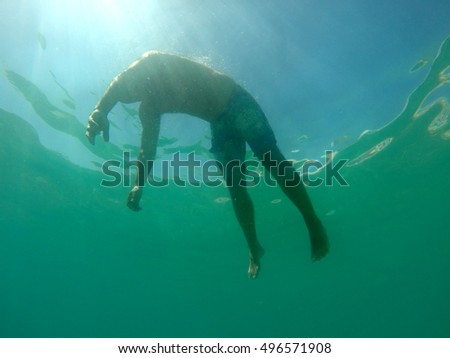 Man drowning viewed from below underwater