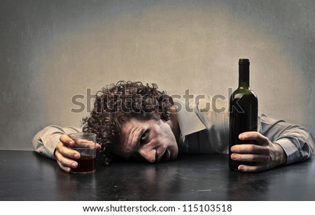 Man drunk with red wine - stock photo