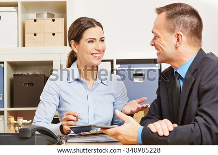 Man during consultation talk with woman for a new insurance - stock photo
