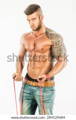 Man during training, muscular body on white - stock photo