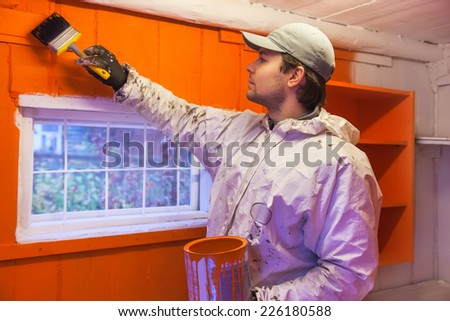 Man dyer in wooden interior. - stock photo