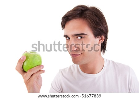 man eating a green apple, on white background. Studio shot - stock photo