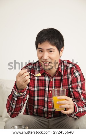 Man eating cereals - stock photo