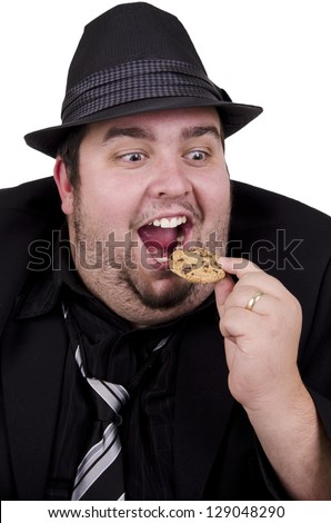 Man eating cookie, isolated on white background.