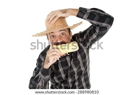 Man eating corn in saint john holiday - stock photo